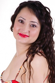Ukrainian girl Tatiyana,39 years old with brown eyes and black hair.