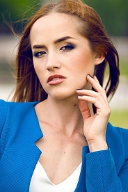 Ukrainian girl Marina,24 years old with green eyes and red hair.