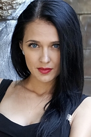 Ukrainian girl Violetta,25 years old with blue eyes and black hair.
