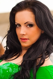 Ukrainian girl Inna,27 years old with green eyes and black hair.