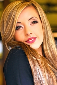 Ukrainian girl Oksana,26 years old with green eyes and light brown hair.
