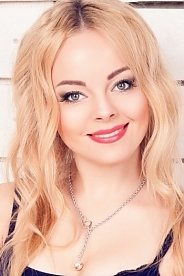 Ukrainian girl Yulia,26 years old with grey eyes and blonde hair.