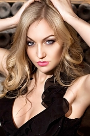 Ukrainian girl Anastasia,24 years old with grey eyes and blonde hair.