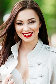 Ukrainian girl Alena,22 years old with green eyes and black hair.