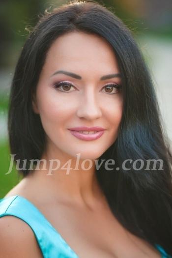 Ukrainian girl Julia,38 years old with hazel eyes and black hair. Julia