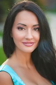 Ukrainian girl Julia,38 years old with hazel eyes and black hair.