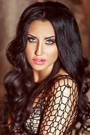 Ukrainian girl Viki,24 years old with grey eyes and black hair.