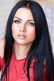 Ukrainian girl Olesya,23 years old with blue eyes and black hair.