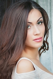 Ukrainian girl Vladislava,25 years old with green eyes and dark brown hair.