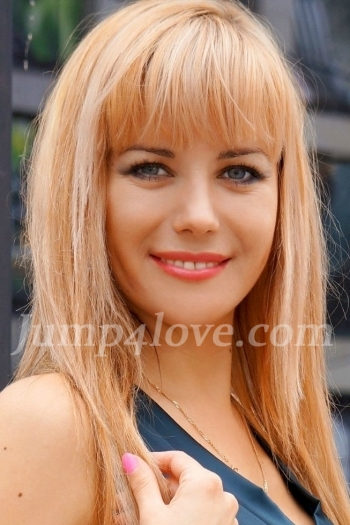 Ukrainian girl Maria,30 years old with grey eyes and blonde hair. Maria