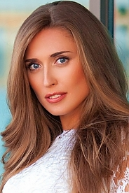 Ukrainian girl Evgeniya,32 years old with blue eyes and light brown hair.