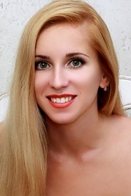 Ukrainian girl Maria,37 years old with green eyes and blonde hair.