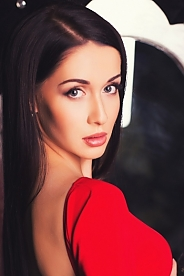 Ukrainian girl Olga,21 years old with blue eyes and black hair.