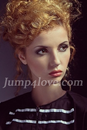 Ukrainian girl Marina,20 years old with brown eyes and red hair. Marina