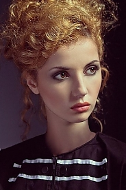 Ukrainian girl Marina,20 years old with brown eyes and red hair.