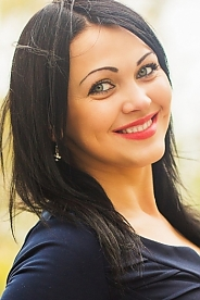 Ukrainian girl Marina,25 years old with green eyes and black hair.