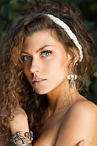 Ukrainian girl Kseniia,21 years old with blue eyes and light brown hair.