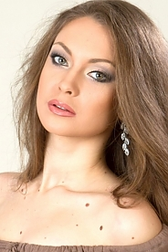 Ukrainian girl Tanya,19 years old with green eyes and light brown hair.