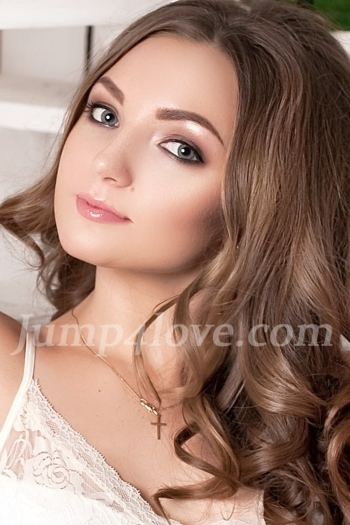 Ukrainian girl Elena,20 years old with blue eyes and light brown hair. Elena