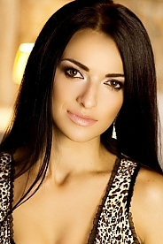 Ukrainian girl Elena,29 years old with green eyes and black hair.