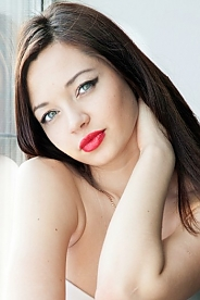 Ukrainian girl Elena ,22 years old with blue eyes and light brown hair.