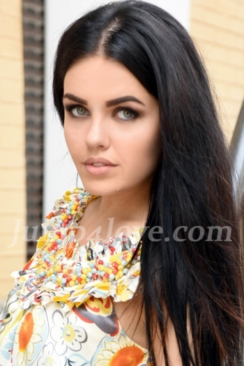 Ukrainian girl Sofia,24 years old with blue eyes and black hair.