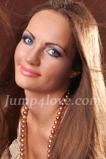 Ukrainian girl Lidia,35 years old with grey eyes and dark brown hair. Lidia