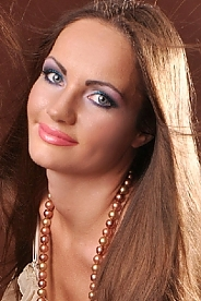 Ukrainian girl Lidia,35 years old with grey eyes and dark brown hair.