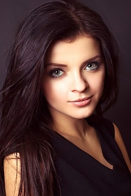 Ukrainian girl Viktoria,18 years old with grey eyes and dark brown hair.