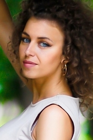 Ukrainian girl Kate,28 years old with blue eyes and light brown hair.