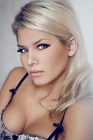 Russian girl Alina,25 years old with blue eyes and blonde hair.
