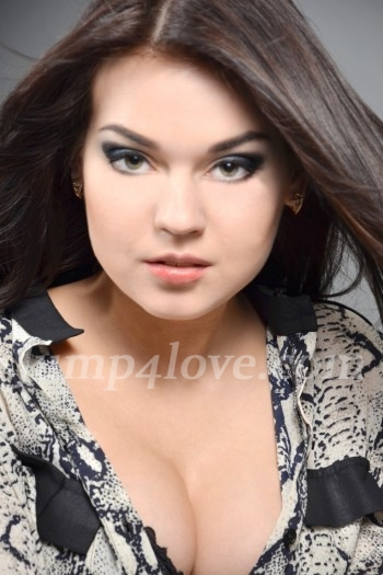 Ukrainian girl Julia,19 years old with green eyes and dark brown hair.