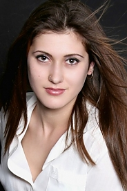 Ukrainian girl Tatyana,18 years old with brown eyes and light brown hair.