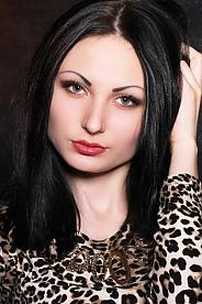 Ukrainian girl Anastasia,23 years old with green eyes and black hair.