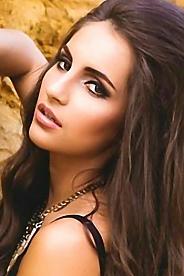 Ukrainian girl Daria,28 years old with green eyes and dark brown hair.