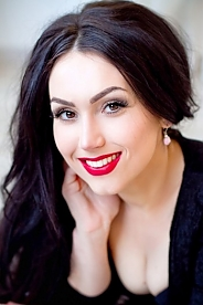 Ukrainian girl Anna,26 years old with brown eyes and black hair.