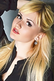 Ukrainian girl Alina,23 years old with brown eyes and blonde hair.