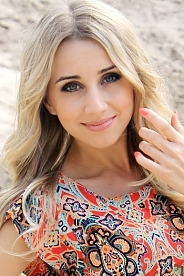 Ukrainian girl Alina,25 years old with green eyes and blonde hair.