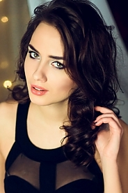 Ukrainian girl Alexandra,20 years old with green eyes and black hair.