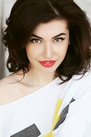 Ukrainian girl Olga,24 years old with brown eyes and dark brown hair.