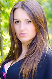Ukrainian girl Aliona,24 years old with green eyes and dark brown hair.