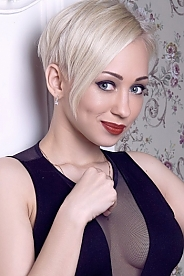 Ukrainian girl Albina,24 years old with grey eyes and blonde hair.
