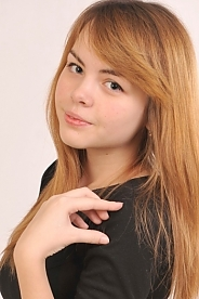 Ukrainian girl Anastasia,19 years old with grey eyes and light brown hair.