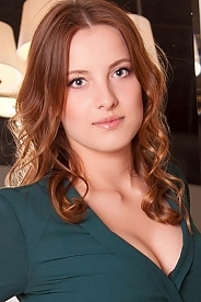 Ukrainian girl Anna,22 years old with grey eyes and light brown hair.