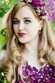 Ukrainian girl Lana ,32 years old with green eyes and blonde hair.