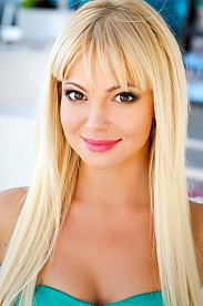 Ukrainian girl Alla,30 years old with hazel eyes and blonde hair.